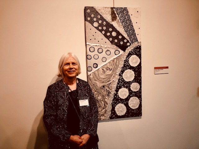 Marklyn Wilson standing next to her art entry